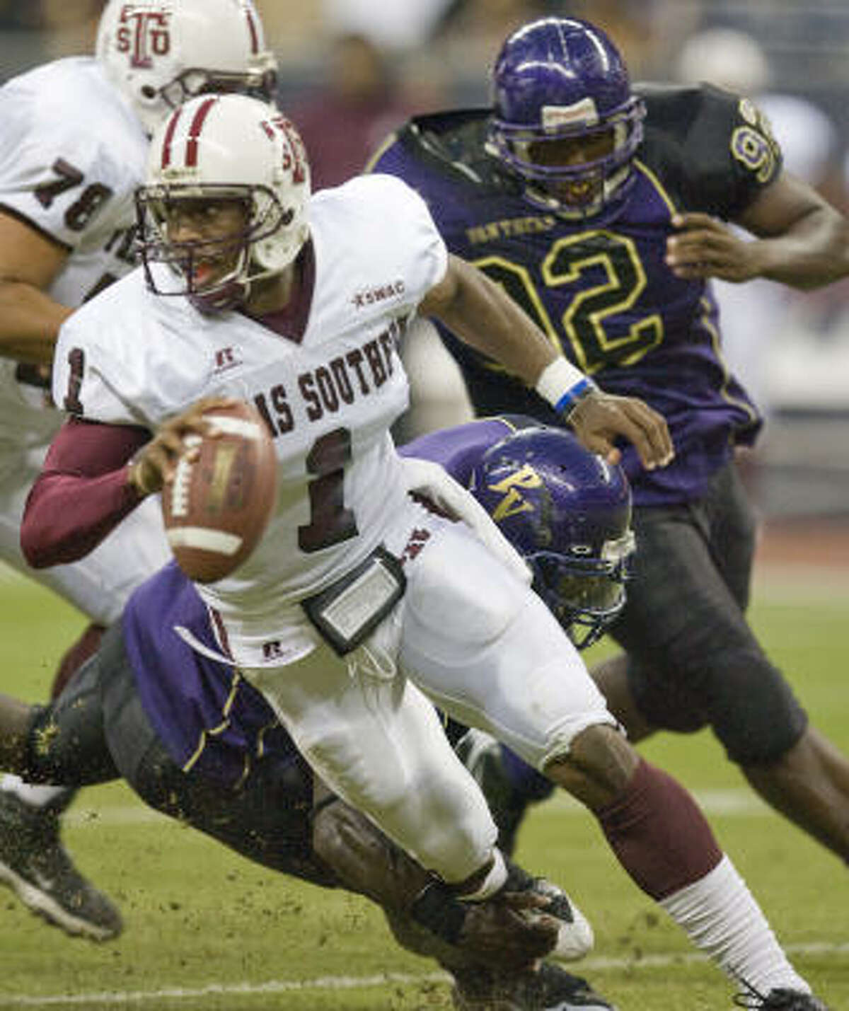ON THE RUN: TSU quarterback Bobby Reid (1) scrambles out of harm's way, much as he did by leaving Oklahoma State to play his final year of college football for the Tigers.