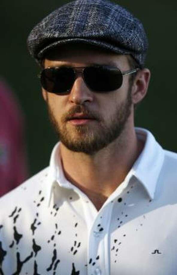 Justin Timberlake sports the flat cap on the golf course. Photo: Isaac Brekken, Associated Press
