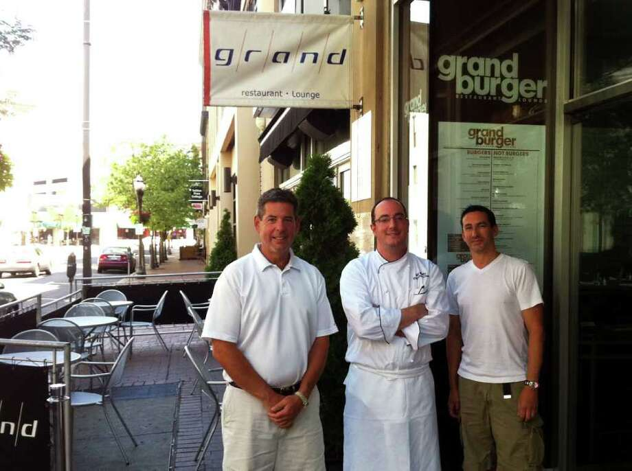 Nick Billelo, center, flanked by Steve Montello, left, and Robbie Cooper, co-owners of Grand Burger, along with Billy Calyanus, is the genius behind the burgers he creates at the Bank Street restaurant in Stamford, Conn. Photo: Rich Lee / Stamford Advocate