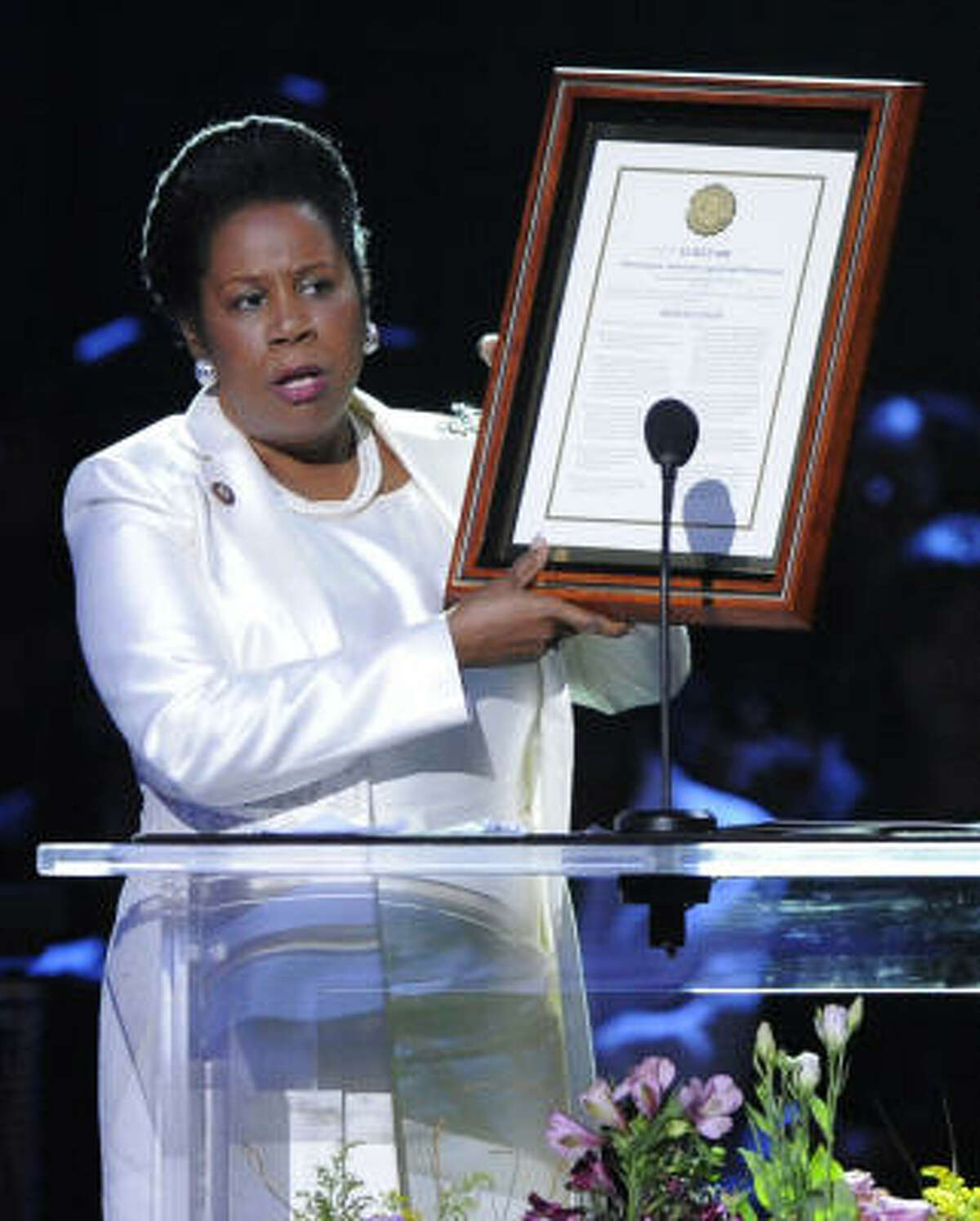 Houston Democrat Sheila Jackson Lee, shown at Michael Jackson's memorial service, where she presented a House resolution that was to honor the singer, says she was invited to the event by Jackson's brother Jermaine.