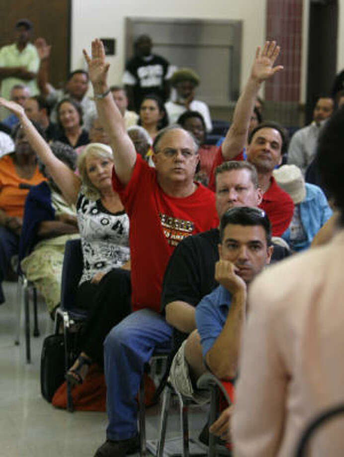 Allan Jamail, center in red, was one of many who had questions for Sheila Jackson Lee during her town hall meeting Tuesday in Houston at the Peavy Neighborhood Center in the Fifth Ward. Photo: Karen Warren, Chronicle