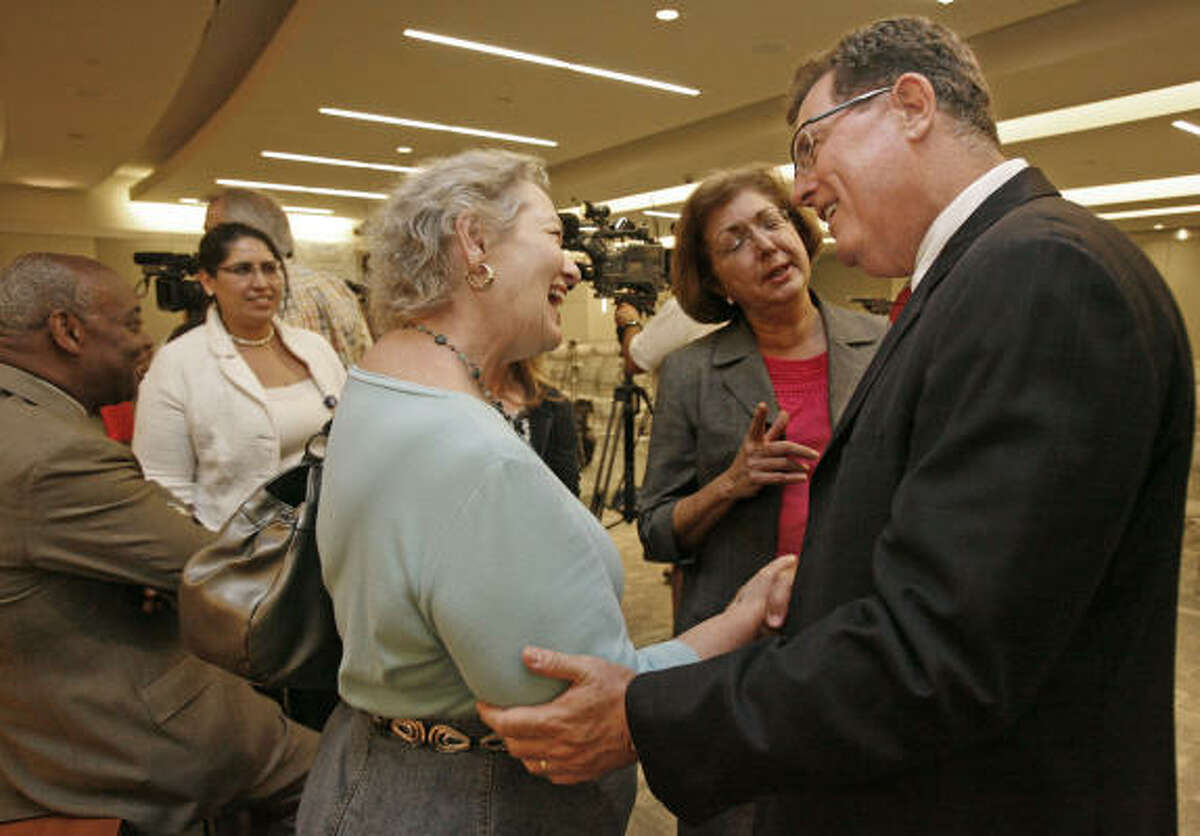 Grier chats with Judy Long, of Parents for Public Schools of Houston.