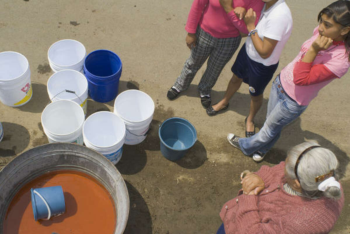 In the San Nicolas neighborhood of Mexico City, there has been no water service for three weeks. One tap to a free-flowing spring is the only water for some people in this section.