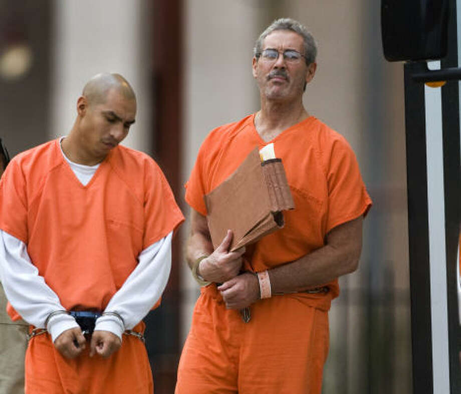R. Allen Stanford, right, arrives at the federal courthouse on Tuesday for his fraud case. Photo: Brett Coomer, Chronicle