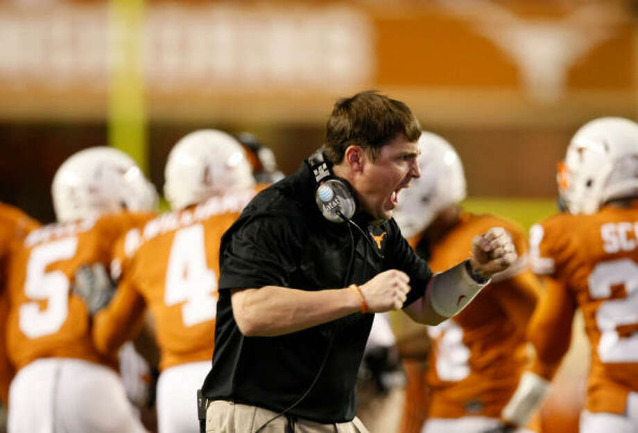 Even his players admit that it's tough to match the energy level of UT defensive coordinator Will Muschamp. Photo: Nick De La Torre, CHRONICLE