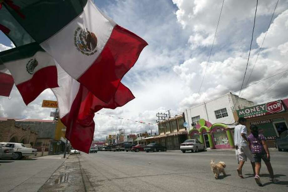 The streets were quiet in Ciudad Miguel Aleman, Mexico, on Friday, two weeks after a gunbattle there that was one of several recently in cities near the border. Photo: EDWARD A. ORNELAS, SAN ANTONIO EXPRESS-NEWS