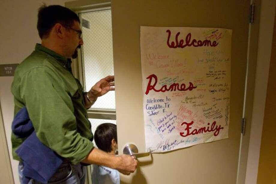 Raul Ramos, a history professor at the University of Houston, enter's into his dorm room with his son Joaquin, 4, at Cougar Village a newly built student housing facility on campus Nov. 16.  Ramos, his wife, Liz, and their sons Joaquin, 4, and Noe, 2, are living the U of H dorm this year as part of the university's Live-in faculty program set up as an effort to keep students more engaged with the campus and, therefore, more likely to stay in school and graduate. The family eats in the dining hall a couple of times a week, and their children play on campus. Photo: Johnny Hanson, Houston Chronicle
