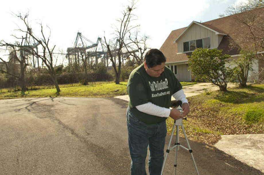 Tony Villarreal adjusts the meter he uses to measure the sound coming from the Port of Houston Authority's Bayport Container Terminal nearby. Photo: Kim Christensen :, For The Chronicle