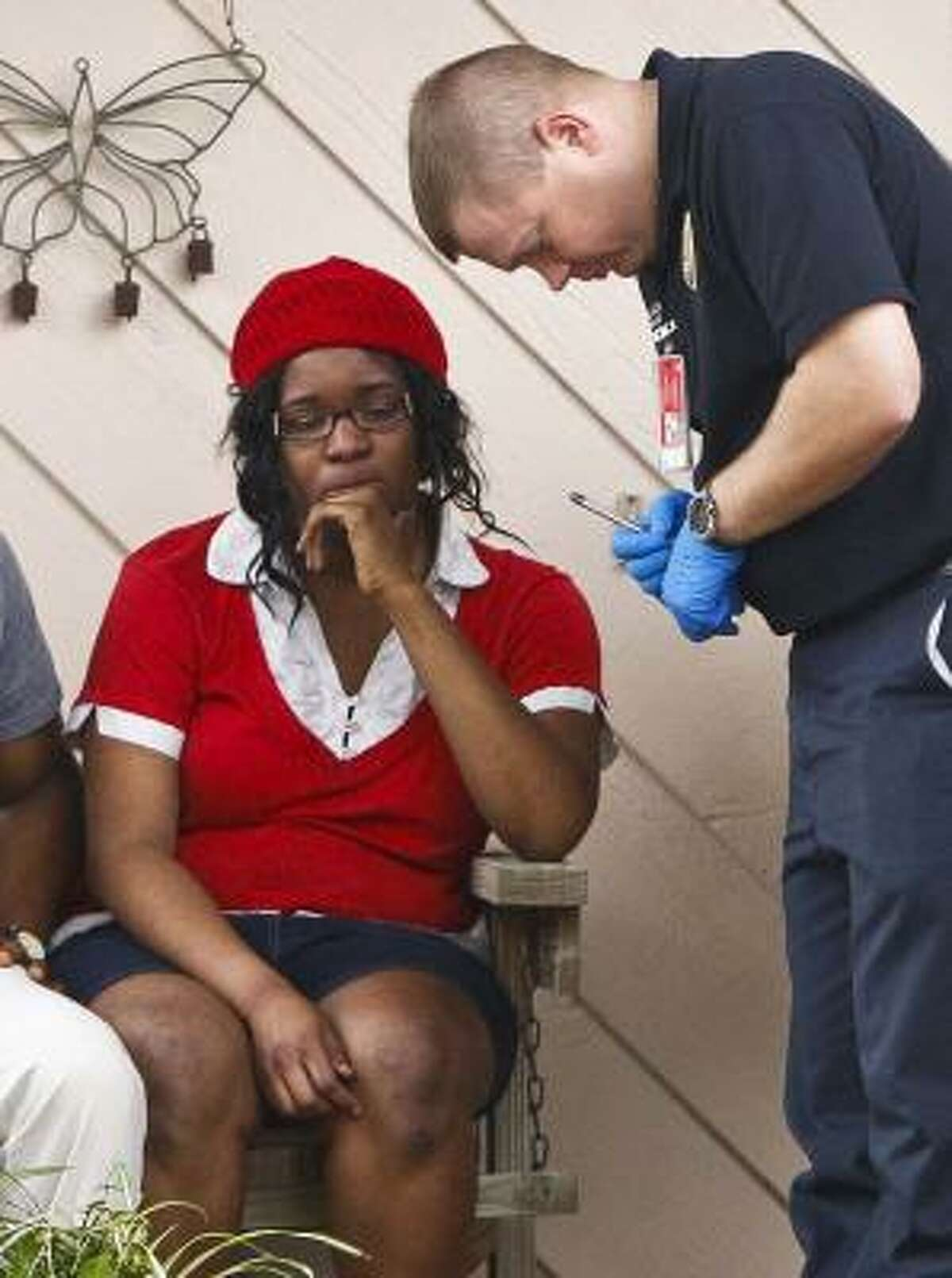 Jessica Tata, 22, operator of Jackie's Child Care, talks with Firefighter Paramedic Randall Riccitelli, after a fire broke out at the day care center Thursday, Feb. 24, 2011, in Houston.