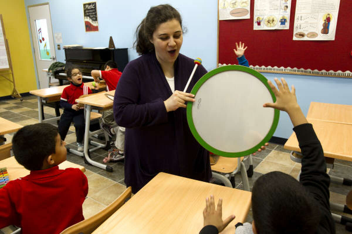 Music teacher Sena Ademoglu works with a classroom of kindergartners at Harmony School of Art and Technology. About 70 percent of Harmony students are in K-8, but at the newer campuses, grade levels are being added each year.