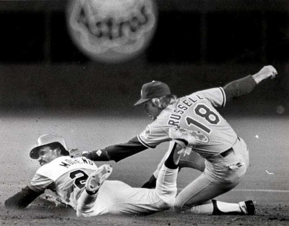 During the Astros season opener in 1983, Omar Moreno is tagged out by Dodgers shortstop Bill Russell. Photo: Steve Ueckert/Houston Chronicle
