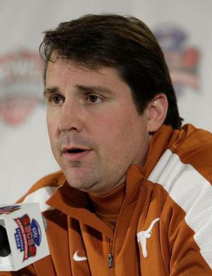 Texas defensive coordinator Will Muschamp said he has no plans to go elsewhere for a head coaching job. Photo: Jae C. Hong, AP