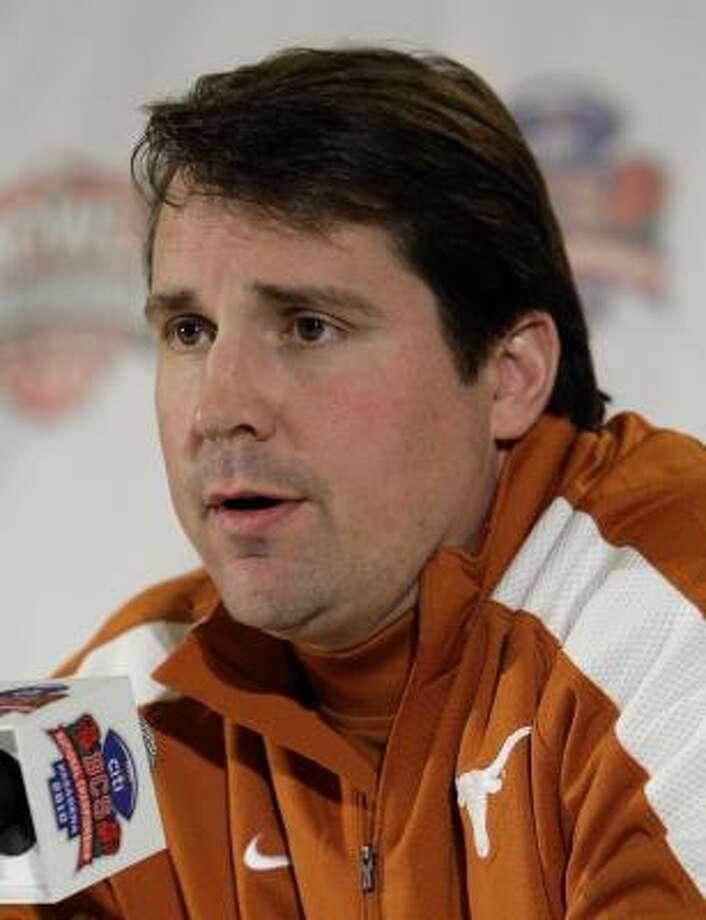 Texas defensive coordinator Will Muschamp said he has no plans to go elsewhere for a head coaching job. Photo: Jae C. Hong, AP