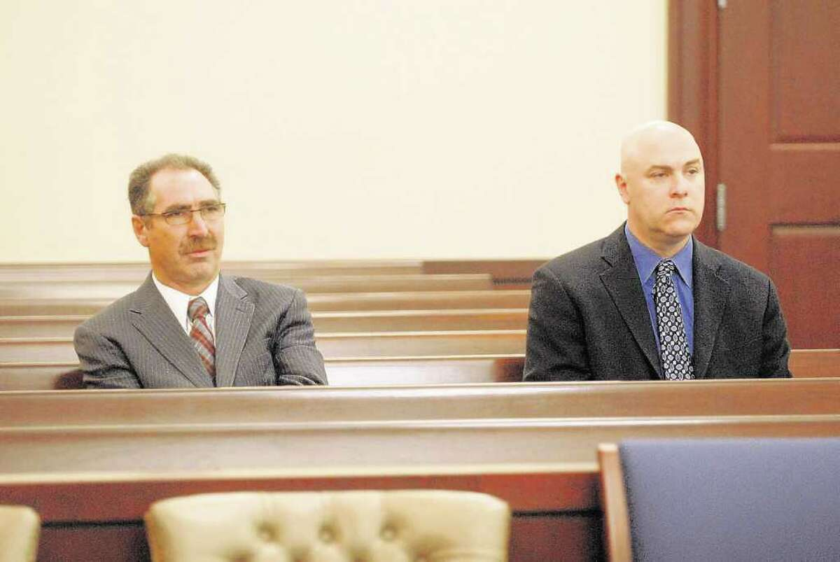 Troy City Councilman Michael LoPorto, left, and Troy City Clerk William McInerney, right, watch proceedings during a hearing in Albany last September regarding a prosecutor's request to obtain their DNA in a ballot-fraud probe. (Paul Buckowski / Times Union archive)