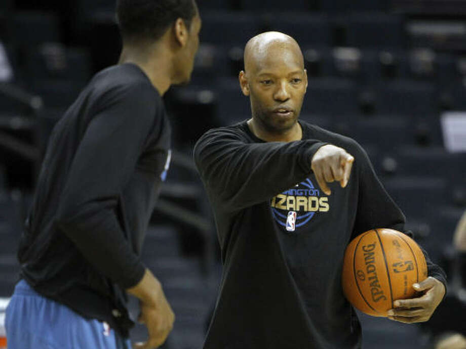 Former Rockets guard Sam Cassell, right, is currently an assistant coach with the Washington Wizards. Photo: Chuck Burton, AP