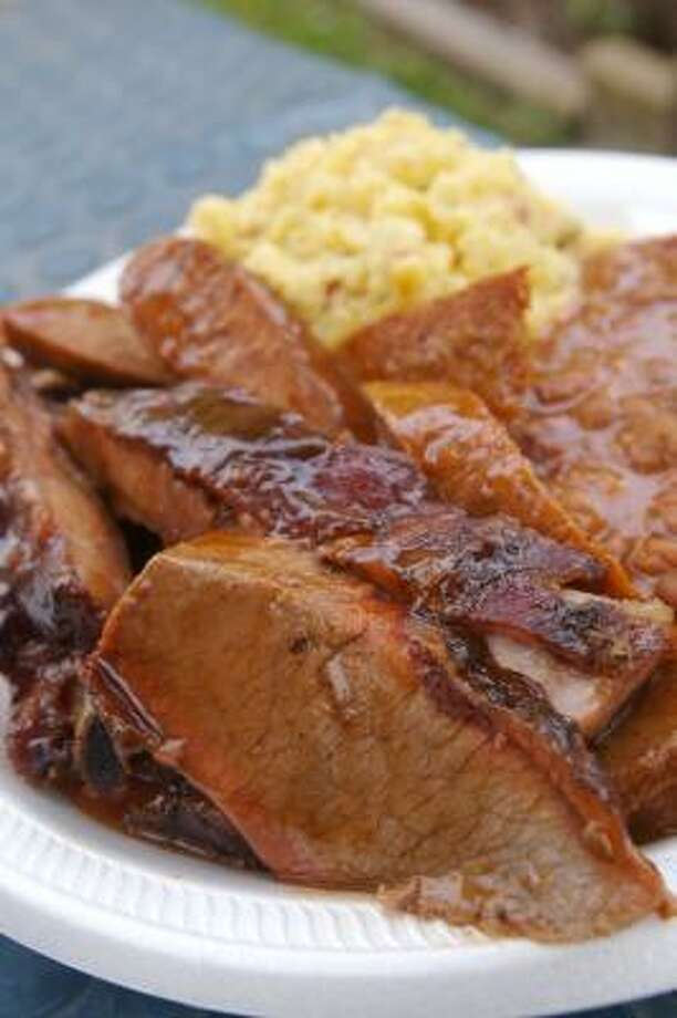 The ribs, links, brisket, potato salad and beans at Burns Bar-B-Q are just five reasons your first visit is unlikely to be your last. Photo: Bill Olive, For The Chronicle