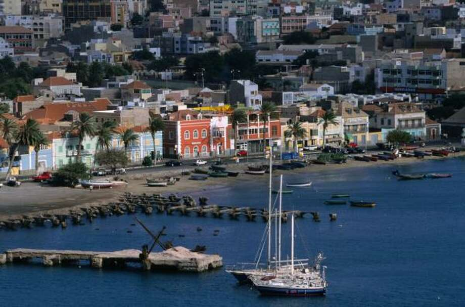 Candy-colored, cobblestoned Mindelo harbors Cape Verde's rich artistic heritage, best evidenced by songstress Cesaria Evora. Photo: Jean Robert, Lonely Planet Images