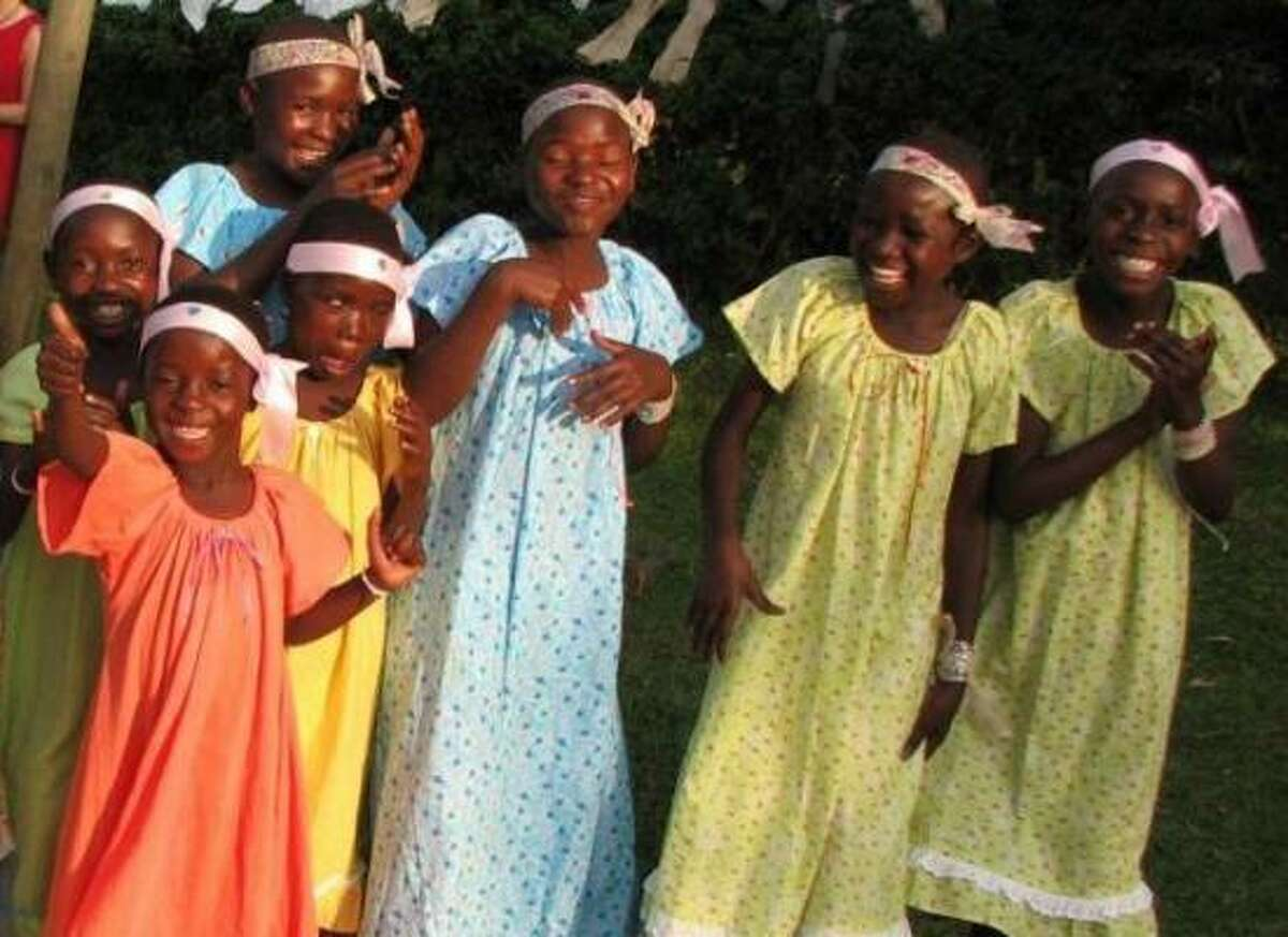 Girls at the Happy Home Orphanage show off gowns made by Cathy Stovall.