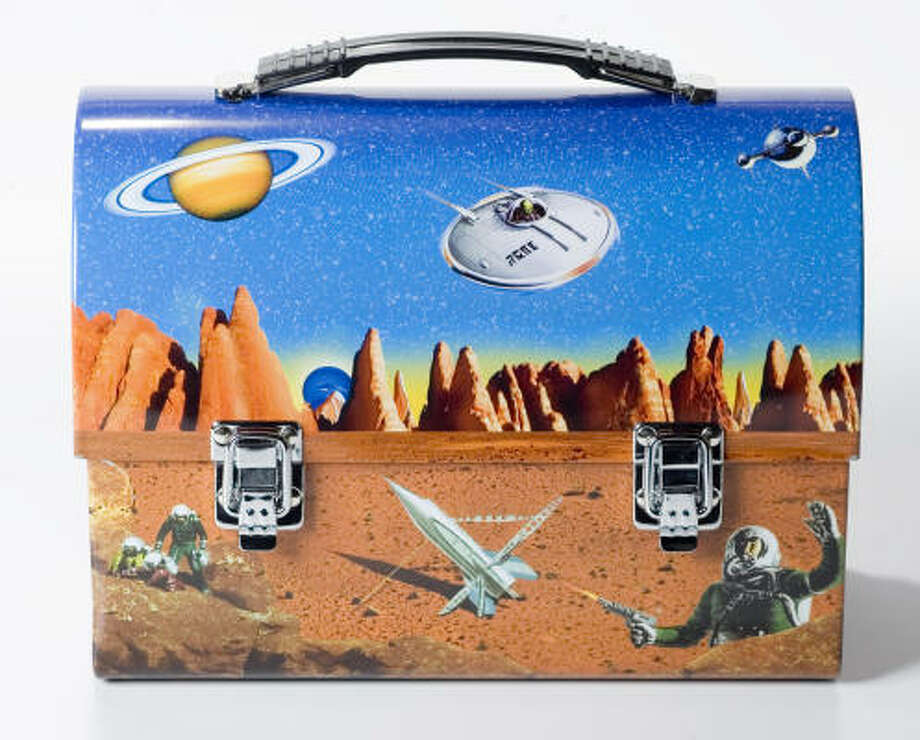 SPACED OUT:This retro metal space lunchbox by Accoutrements is out of this world. Photo: Buster Dean, Chronicle