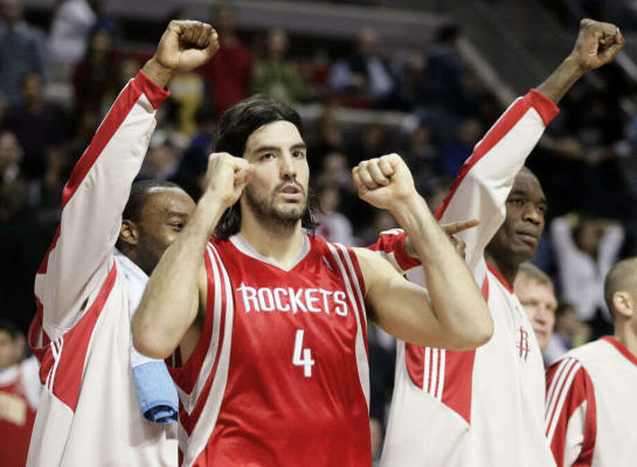 Luis Scola enjoys Sunday's victory. Photo: Duane Burleson, AP