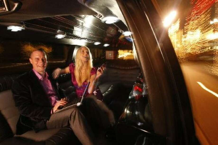 Douglas Britt and Lindsey Love will be covering Houston's biggest society events. Limo provided by Onyx Limousines. Photo: JOHNNY HANSON, CHRONICLE