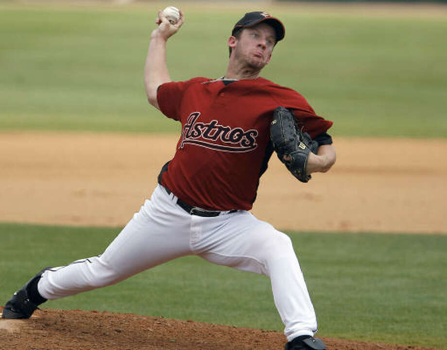 Roy Oswalt strikes out Miguel Cairo to end the fifth Friday. It was Oswalt's first outing for the Astros since Feb. 26. Photo: David Maialetti, MCT