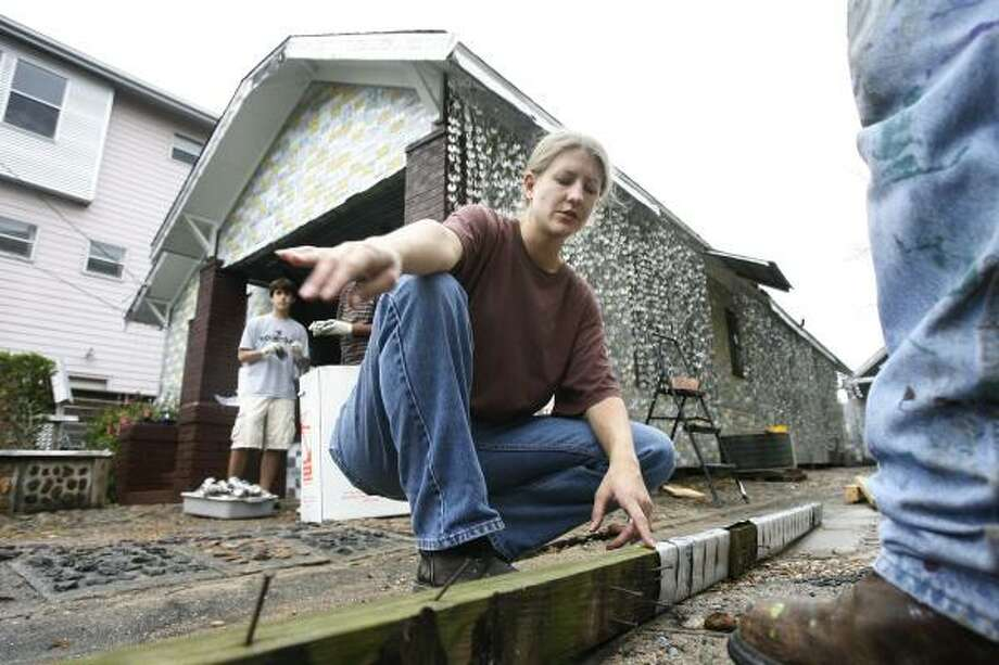 CAN-DO APPROACH:As project manager, Julie Birsinger had to figure out how to renovate a house covered in beer cans. Photo: JAMES NIELSEN, CHRONICLE