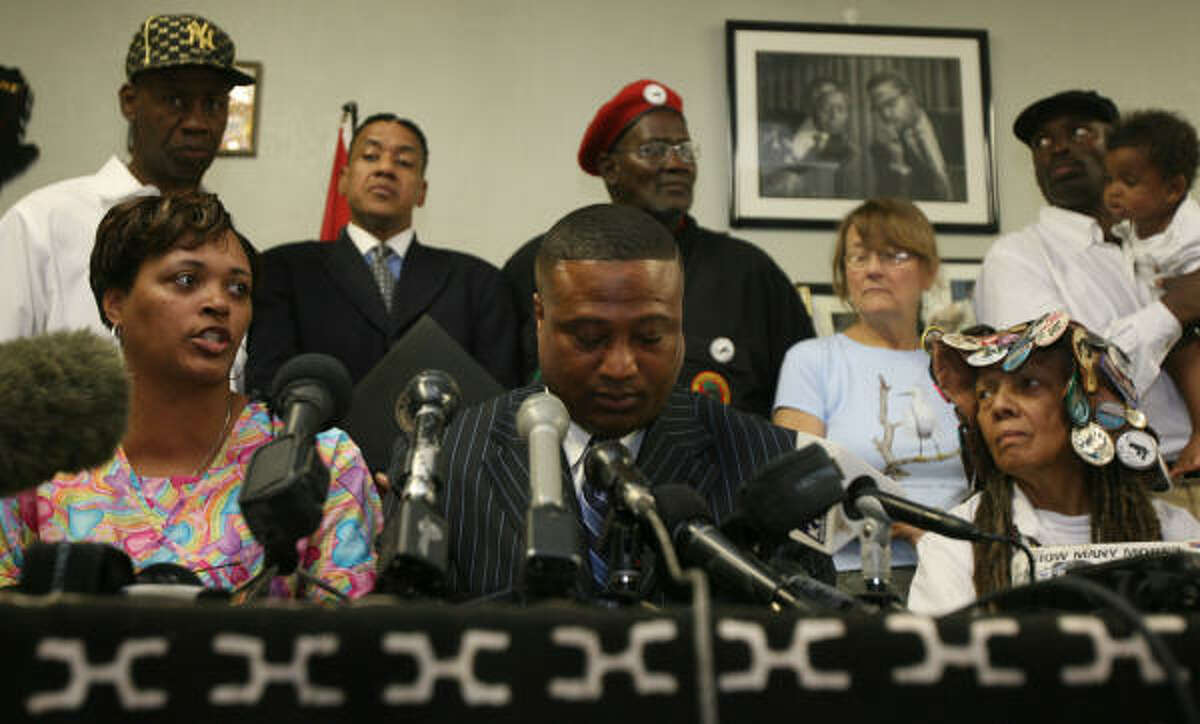 """Stephanie Storey, left, shown with Quanell X, center, and other activists at a news conference on Tuesday, called Joe Horn's shooting of her fiance, Hernando Riascos Torres, and Diego Ortiz """"premeditated murder."""""""