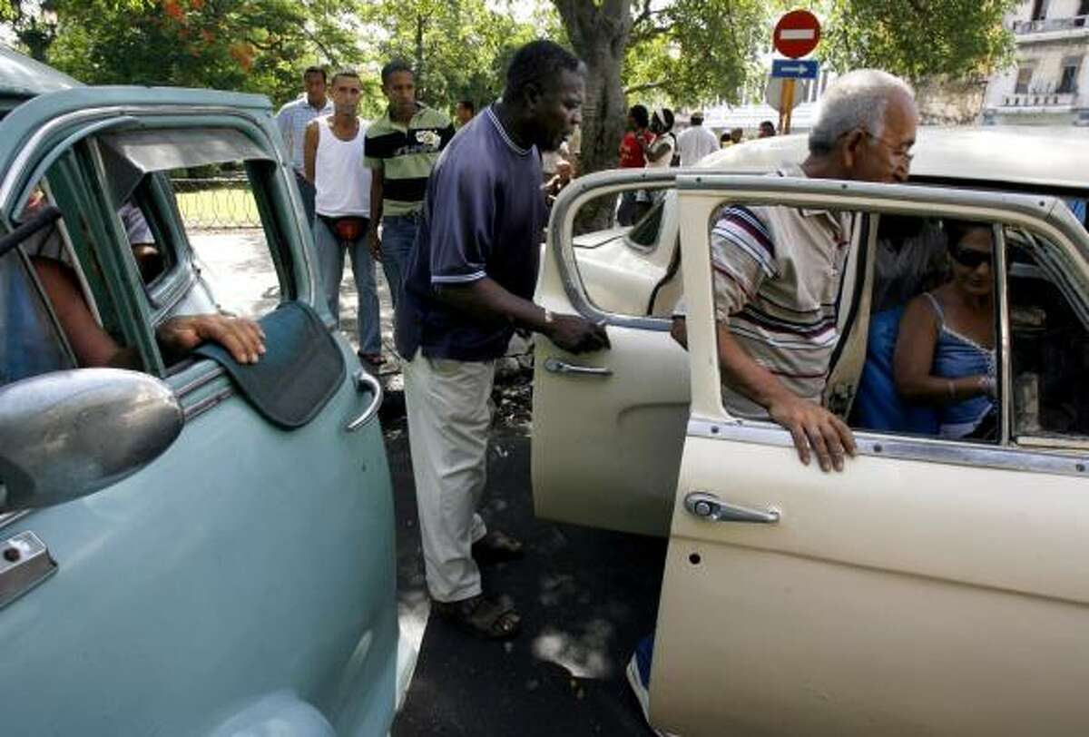 Passengers get in a classic American car used as a taxi in the Cuban capital. President Raul Castro will soon allow private citizens to use their cars as cabs for the first time since 1999.