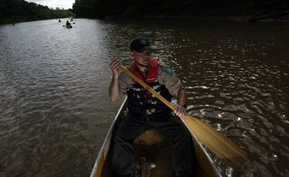 Steve Killian, manager of Brazos Bend State Park, accompanies a group on a recent excursion on the Brazos. The group envisions it as a Texas Paddling Trail and wants state and private funding to create more public access points on the river. Photo: JOHNNY HANSON, CHRONICLE