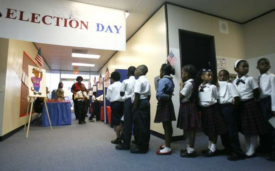Students at the Girls and Boys Preparatory Academy line up to cast their ballots Friday in the student council election. For video, go to chron.com Photo: KAREN WARREN, CHRONICLE