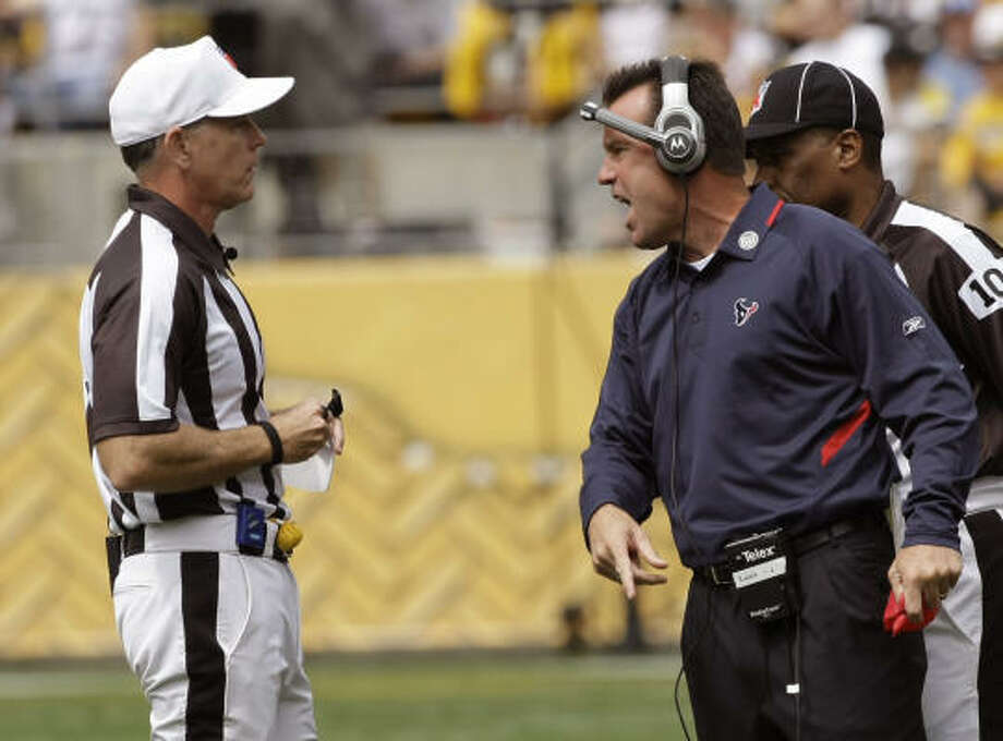 Texans coach Gary Kubiak, right, argues a spot call with referee Terry McAulay in the first quarter. Quarterback Matt Schaub came up short on a fourth-and-one play near midfield, resulting in a turnover. Photo: Brett Coomer, Chronicle
