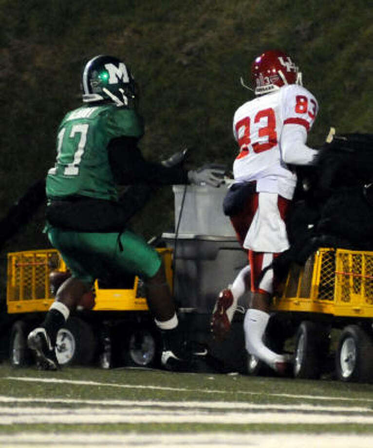 UH's Patrick Edwards breaks his leg during the game at Marshall on Tuesday. Photo: Howie McCormick