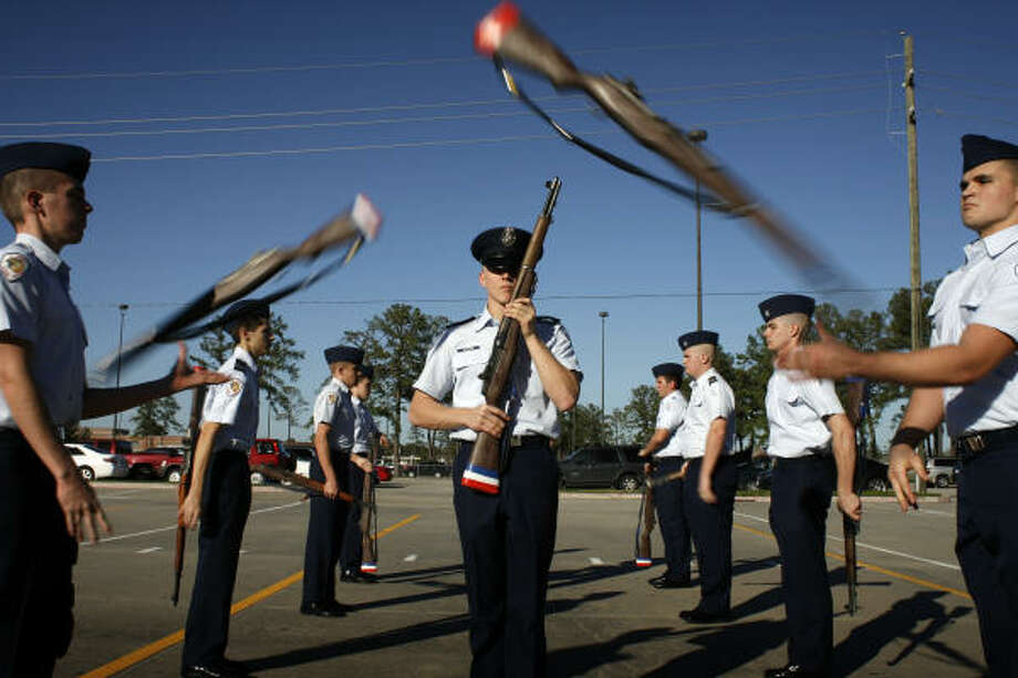 M1 rifles fly past Cpt. Jacob Ackman, 17, as the Air Force JROTC drill team from the Klein Collins High School practices in Spring. The team will appear in Obama's inaugural parade. Photo: Eric Kayne |, Chronicle