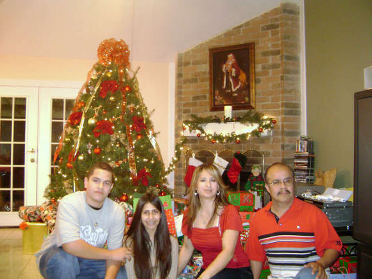 Homero Rosales, right, is shown in a family photo with his family, from left: son, Omar, 16, daughter, Erica, and wife, Lydia Rosales. Homero Rosales was killed in east Houston after the vehicle he was driving in was struck by a driver of a truck that was being chased by police.
