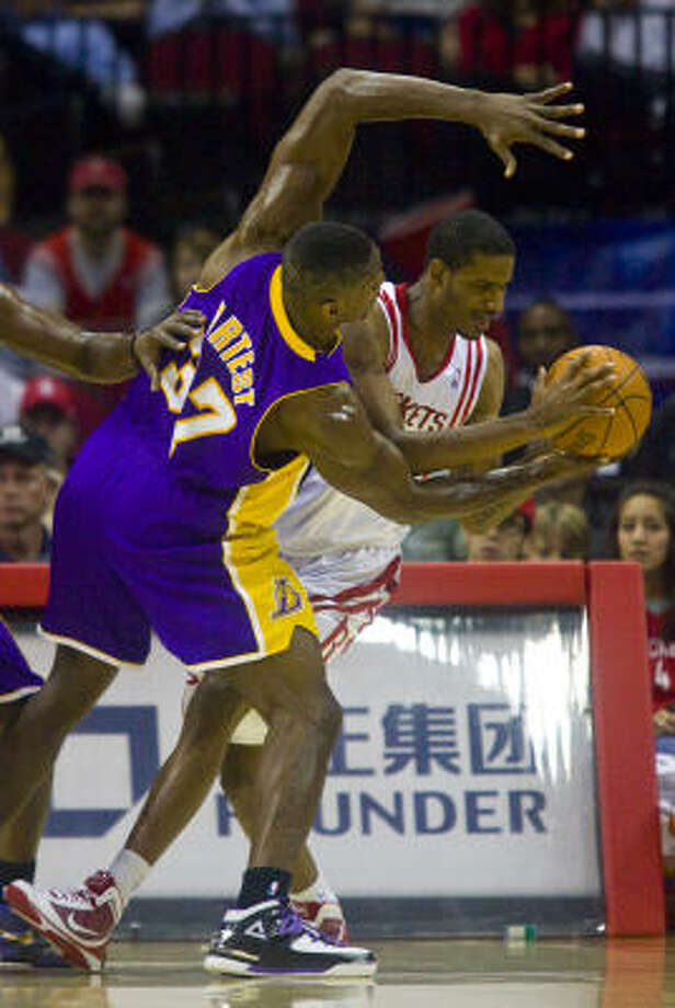 Trevor Ariza and Ron Artest, the player the Lakers chose instead for their title defense, generally played to a draw. Both finished with 15, including the back-to-back 3s that sent the game into overtime. Photo: Karen Warren, Chronicle
