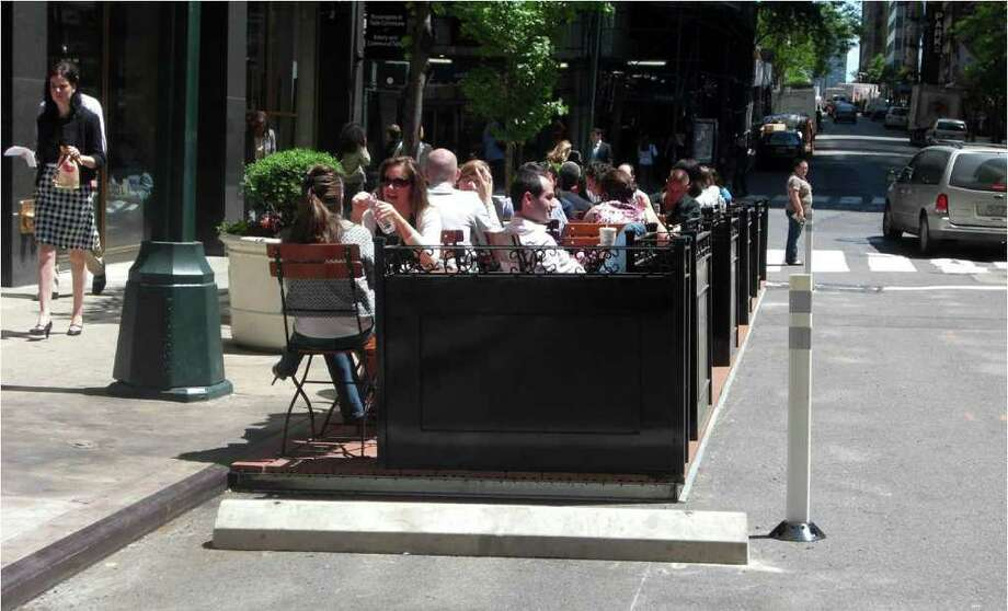 Pop-out seating, seen here at 44th Street and Third Avenue in Manhattan, converts parking spaces into outdoor dining areas. Photo: Contributed Photo / Westport News contributed
