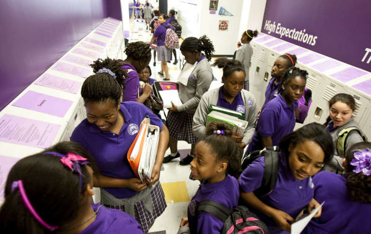 Girls chat as they change classes at the KIPP Voyage Academy for Girls in Houston. HISD is adding a similar campus.