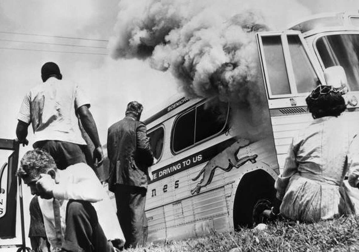 In Anniston, Ala., an angry mob stoned and firebombed a Greyhound bus holding some of the original Freedom Riders.