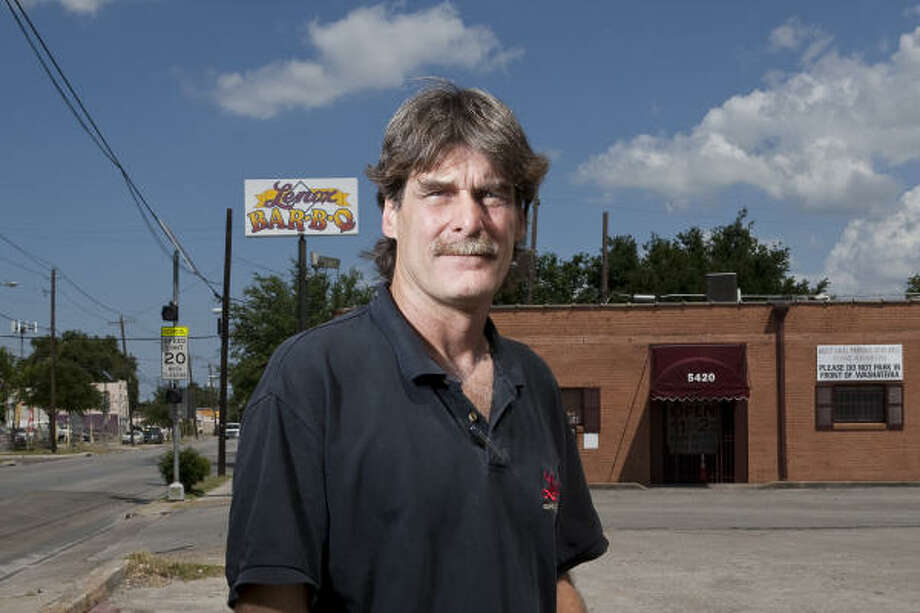 Erik Mrok, owner of Lenox Barbecue, stands outside his restaurant that has closed due to Metro light rail line construction. Photo: Nathan Lindstrom, Chronicle