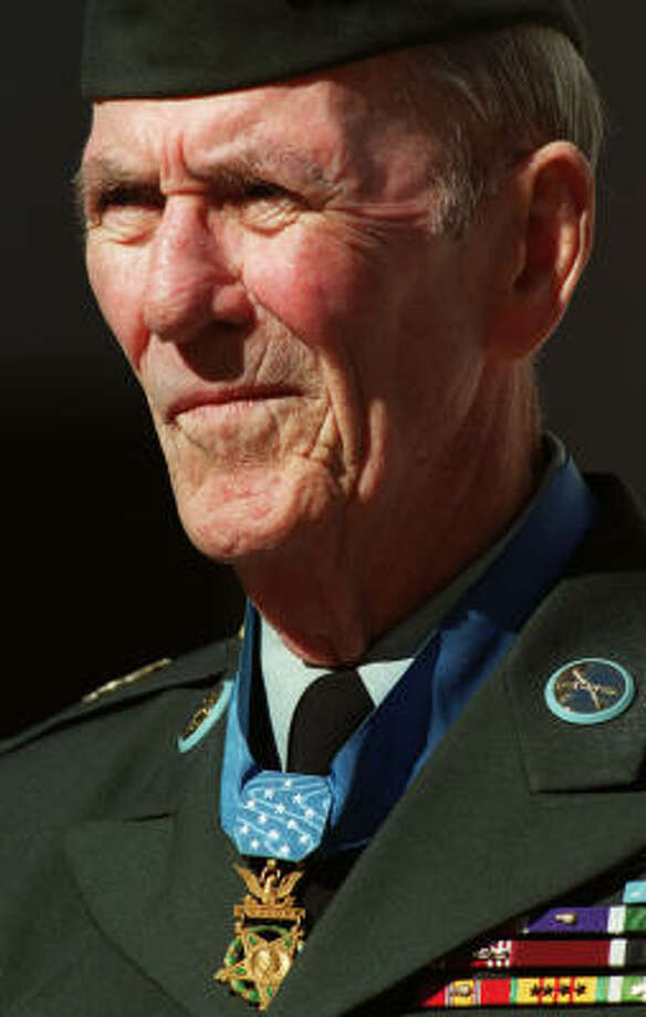 David McNerney led the Pledge of Allegiance on Veterans Day, 2002, in Houston. Photo: Steve Ueckert, Houston Chronicle