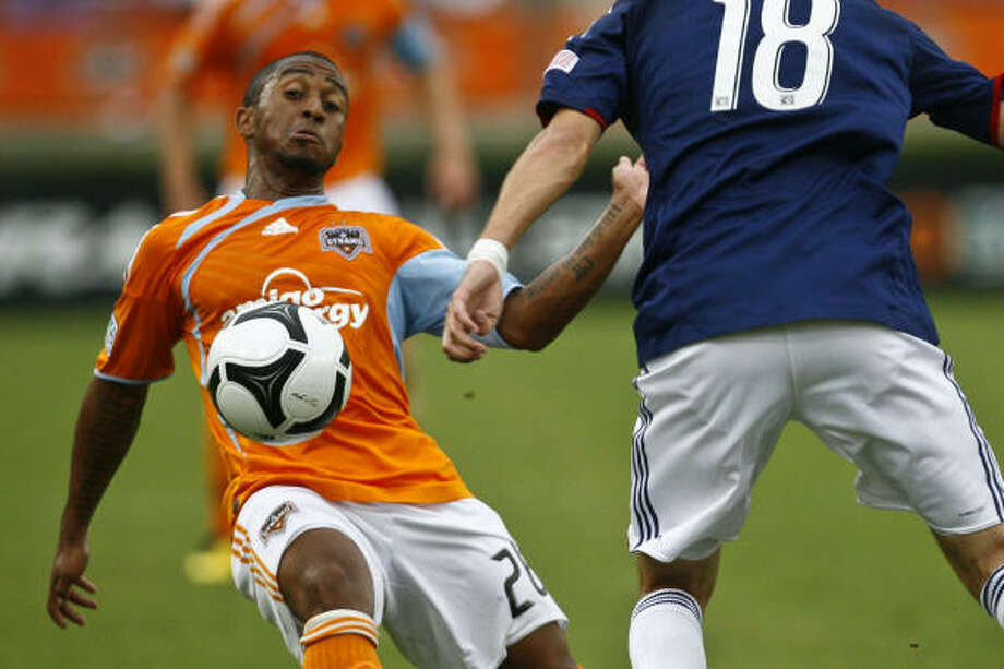 Corey Ashe started a career-high 19 games last year, primarily as a midfielder. Photo: Michael Paulsen, Chronicle