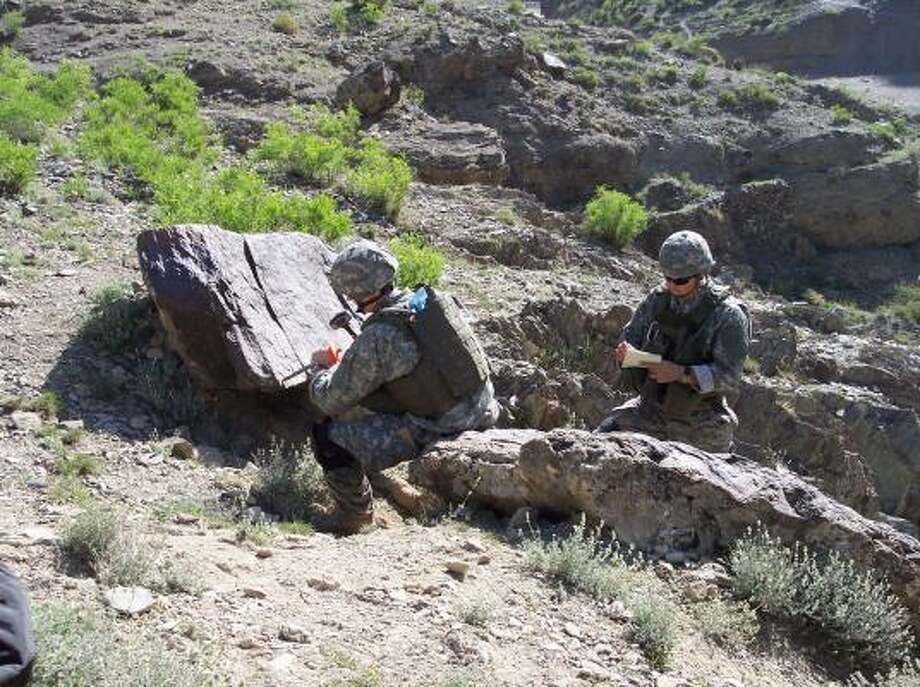 This handout photo released by the United States Army Criminal Investigation Command in March 2007, shows a military re-enactment of the incident that took the life of Spc. Pat Tillman and wounded fellow Army Rangers Lt. David Uthlaut and Spc. Jade Lane. Photo: AP File