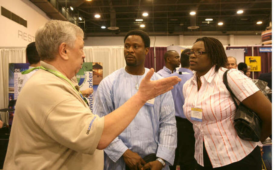 Bill French, left, executive search director with Worldwideworker.com, talks with James Omaruaye and Chidi Konkwo of Nigeria on Tuesday at the Offshore Technology Conference. ``Companies are having to get creative'' to find new employees, French said. Photo: Steve Campbell, Chronicle
