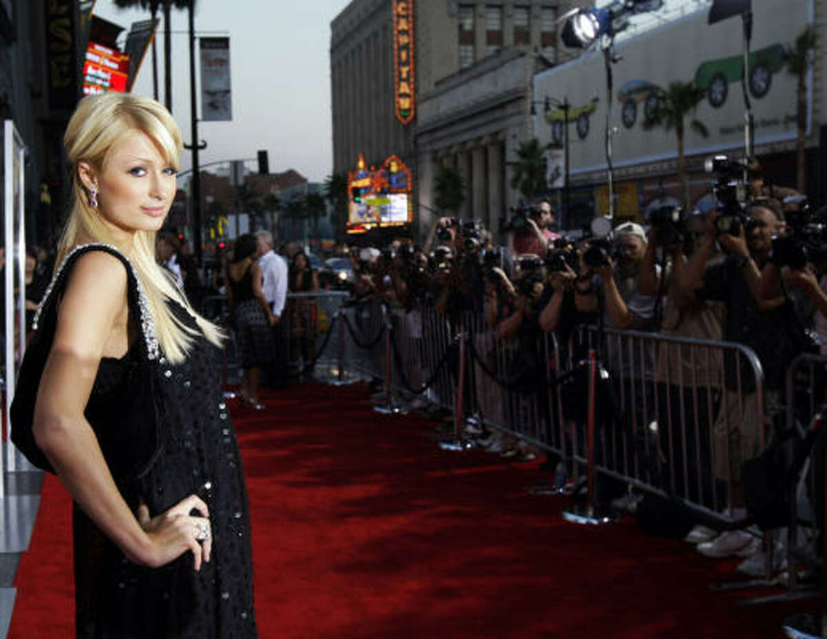 Paris Hilton poses as she arrives at the premiere of the film Rush Hour 3 Monday at Mann's Chinese Theater in Los Angeles.