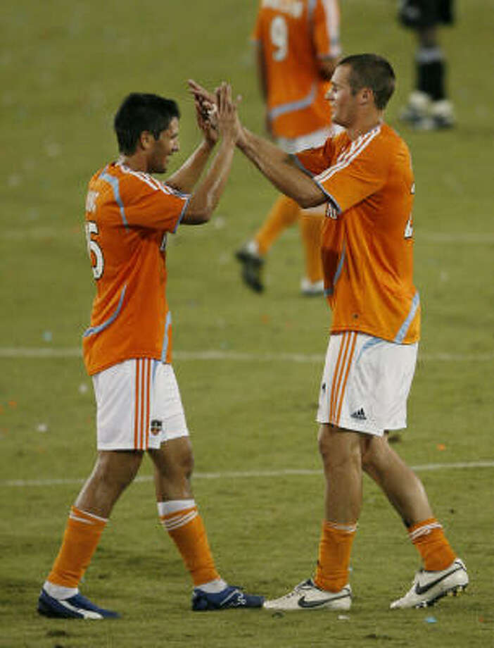 The resurgance of Brian Ching, left, and new additions like Nate Jaqua have taken the Dynamo to the top of the MLS' s Western Conference. Photo: Kevin Fujii, Chronicle