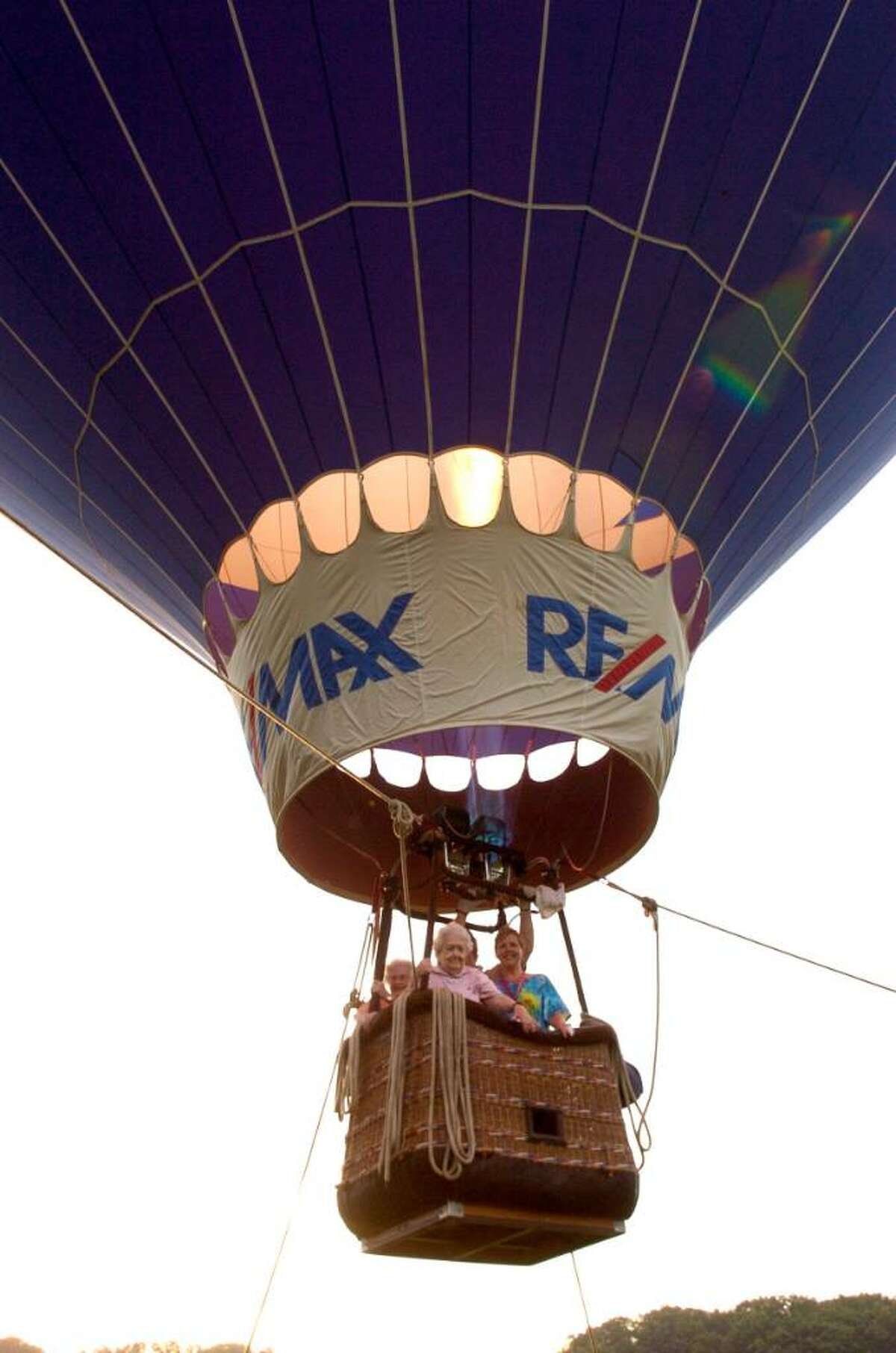 Marjorie Casagrande, left and Bette Broderick, residents of Cascades with Patty Scalvo, director of recreation, go up in a hot air balloon. Photo taken July 28, 2009