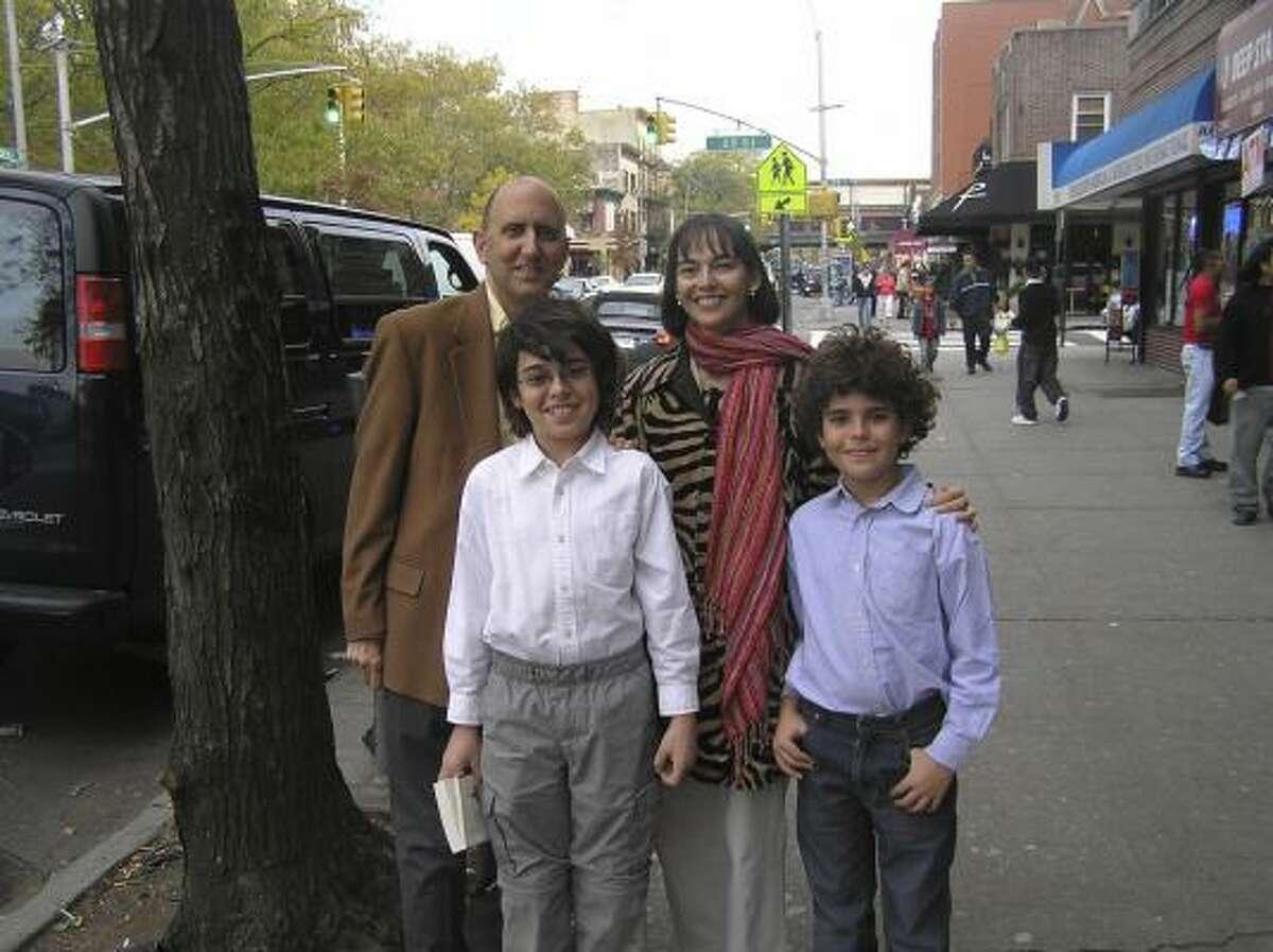 Lenore Skenazy's husband, Joe Kolman, from left, Skenazy's son Morry Kolman, 12, Skenazy and Skenazy's son Izzy Skenazy, 10.