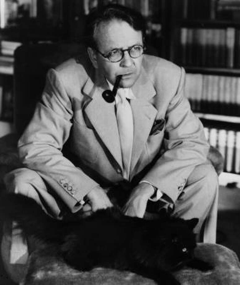 Mystery writer Raymond Chandler communes with Taki, his favorite cat, in this undated photo. Photo: JOHN ENGSTEAD, DUTTON