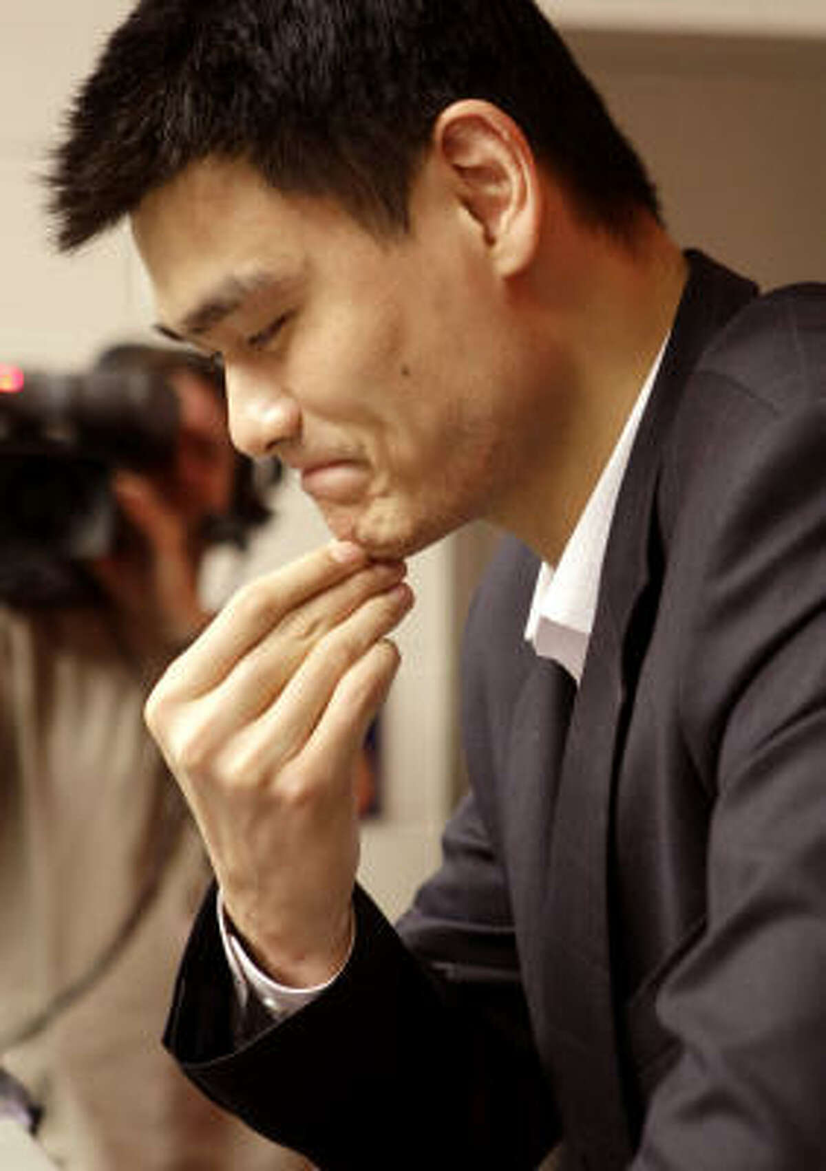 Houston Rockets center Yao Ming answers questions during a news conference after the announcement that Yao will be out for the season with a stress fracture to his left foot Tuesday, Feb. 26, 2008, in Houston.